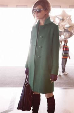 Fall fashion: green coat + high socks.