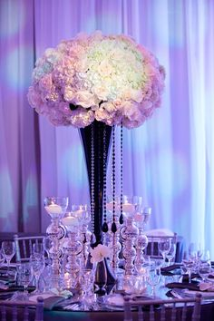 Stunning tal pink and white centerpiece in black vase.