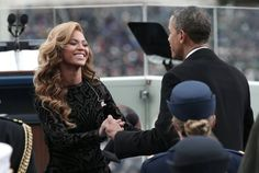 President Barack Obama greets singer Beyonce after she performs during the presidential inauguration in Washington, 01/21/13.