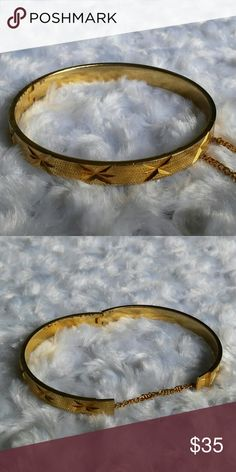 "1930s Victorian Revival Starburst Hinged Bangle Gorgeous frosted Gold tone finish has starbursts cut into in. It has a hinged closure and a safety chain. There are a couple of dings in the finish on one side of the underside by the hinge which you can see in the picture. Measures 1/4"" wide and 7 1/2"" around or 2 1/2"" in diameter. Vintage Jewelry Bracelets"