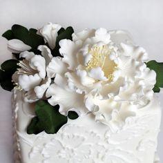 Large white gumpaste peony spray arrangement handmade cake decoration.   CaljavaOnline.com #caljava #gumpaste #sugarflower