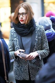 Even a smart snakeskin blazer doesn't distract from deep red lips and tortoiseshell frames #streetstyle