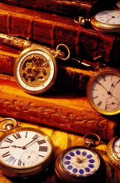 Photograph by Garry Gay of antique books and pocket watches