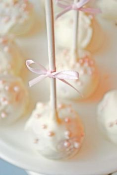 donut holes dipped in chocolate, served as cake pops! What an easy way to do this!
