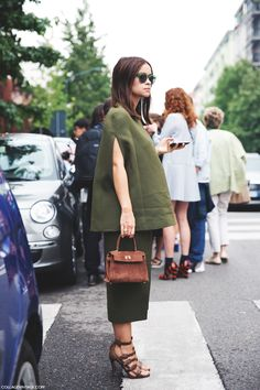 Milan Fashion Week Spring_Summer 15 #MFW #StreetStyle : Miroslava Duma chic in khaki jacket-skirt suit teamed w/ mini Hermés Kelly bag
