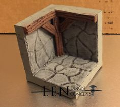 """A prototype of the Wall Corner. This piece has a 2"""" X 2"""" footprint, a carved stone look and wooden support beams. Available in both a durable resin and a durable hydrostone compound. Completely compatible with any terrain that uses 18mm to 25mm scale, including Dwarven Forge, Dungeonstone and Hirst Arts."""