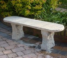 The Rustic Natural Granite Bench has no pretensions and blends easily into the landscape.