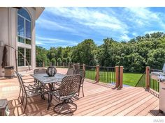 Not only can you entertain on the large deck of this Chesterfield, MO home, but there's plenty of room for the little ones to run around on the lawn, too!
