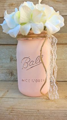 This is a quart size Ball mason jar that has been painted in pink, lightly distressed and finished to perfection. Makes a great centerpiece for your party or home. Flowers, lace and other embellishmen