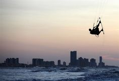 Dec. 6, 2012: Kite surfer Ken Ruiz practices at Bocagrande Beach at the start of the kite surfing season in Cartagena, Colombia. (© Joaquin Sarmiento/Reuters)