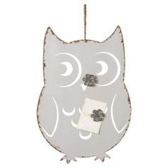 Hanging owl magnet board with a distressed finish.  Product: Magnet boardConstruction Material: MetalColor: WhiteFeatures: Distressed finishDimensions: 20.5 H x 14 W x 0.125 D
