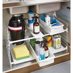 Our Expandable Undersink Organizer easily adjusts to fit around pipes under your sink. It expands from side-to-side and you can change the height of the shelves. You can even remove a shelf or two in order to accommodate a garbage disposal or low hanging pipe. Two pull-out bins make retrieving supplies easy.