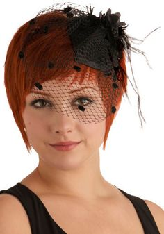 Besides the fact that she looks like she's going to a funeral, simple fascinator would be fun in a different colorway.  Looks good with short hair and little effort.