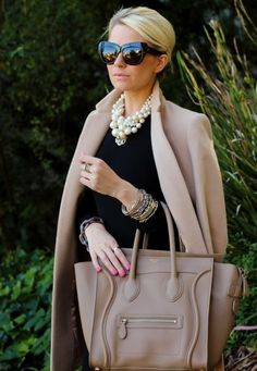 Classically Rich Ensemble - Classic Coat, Statement Bag, Rich Jewelry, Large Sunglasses, LBD, Sophisticated Hairstyle