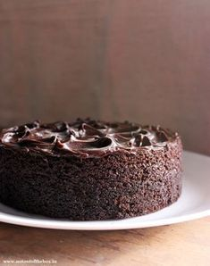 The best ever Eggless Dark Chocolate Cake, moist, sinfully chocolaty and truly delicious. Easy to make, turn this cake into a chocolate sponge for any of your parties and have fun with the frosting. Eggless Desserts, Eggless Recipes, Eggless Baking, Baking Recipes, Cake Recipes, Dessert Recipes, Too Much Chocolate Cake, Dark Chocolate Cakes, Chocolate Sponge