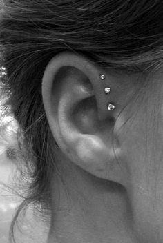 Ideas for piercing ear cute triple forward helix Triple Piercing, Ear Piercings Tragus, Front Helix Piercing, Small Nose Piercing, Chest Piercing, Three Ear Piercings, Female Piercings, Ear Piercings Chart, Tattoo Girls