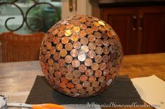 Here is a tutorial on how I finished up the penny ball by applying grout and sealer. I believe it makes a difference, both aesthetically and functionally. If you miss the tutorial yesterday  on how...