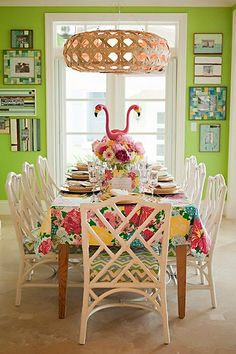 White rattan dinning chairs in colorful room.