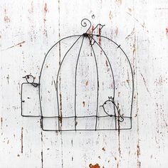 wire cage and birds-with a stained glass bird:)