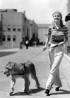 Ginger Rogers walking a lion. c.1930s