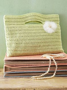 Get a handle on all your necessities with this crocheted purse made from a single crochet panel. The handle openings are formed by skipping stitches as you crochet the rows. Fold the panel in half and stitch the sides togethe
