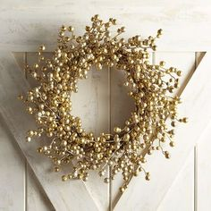 """Looking for a can't-miss, family-favorite holiday wreath? Consider our glitter-kissed berry design. It adds a cheerful burst of golden shimmer above your mantel that lasts all season long. <br> <a href=""""http://www.pier1.com/26%22-wreath-storage-bag/3106470,default,pd.html#nav=pdpdetails"""" target=""""_blank"""" onClick=""""pageTracker._trackEvent('Product_Page', 'Description_Link-Rug_Pad')"""">Store this in our 26"""" Wreath Storage Bag</a>"""