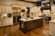 I love the cream cabinets with the dark wood island and floors