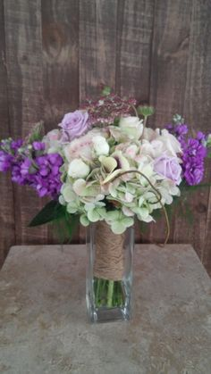Bridal bouquet w/lavender stock and roses, green antique hydrangea and cream roses wrapped with twine