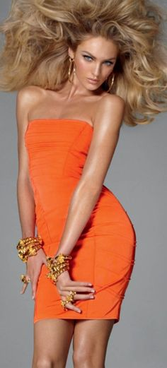 And God created woman......,.Candice Swanepoel in orange sexy dress and movie star big hair