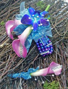 Pink callas, blue orchid & lots of bling #prom flowers
