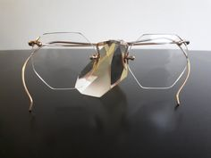 American Optical AO gold rimless wel flex eyeglasses with octagonal bifocal glass lenses from the 1940s with cable temples Brille