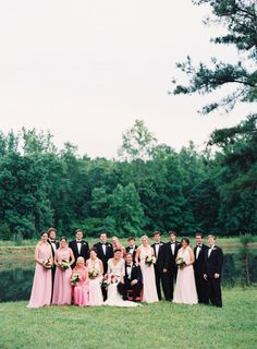 Group shot in front of pond. Bride and Groom Seated Photography by adambarnesphoto.com