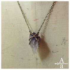 Brass wrapped raw amethyst crystal pendant necklace