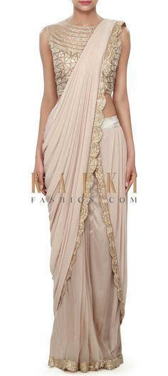 Buy Online from the link below. We ship worldwide (Free Shipping over US$100) Price- $439 Click Anywhere to Tag http://www.kalkifashion.com/brown-saree-gown-adorn-in-cowl-drape-only-on-kalki.html Saree Draping Styles, Saree Styles, Lace Saree Designs, Saree Jacket Designs, Drape Gowns, Drape Sarees, Dhoti Saree, Saree Gown, Hijab Saree