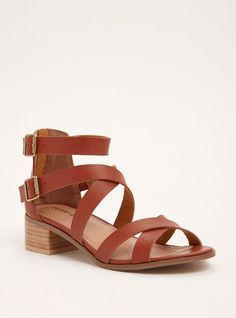 """We know you have a shoe addiction...but this pair is a must-have. We're enablers, what can we say? The mini block heel dresses up the look ever-so-slightly while the crisscrossing cognac faux leather straps lend a goes-with-everything look.<div><ul><li style=""""list-style-position: inside !important; list-style-type: disc !important"""">TRUE WIDE WIDTH: Designed so you never have to size up again. For the perfect fit, we recommend going down a whole size.<&#..."""