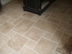 Travertine floor for kitchen. want this! so much more interesting than square tiles!