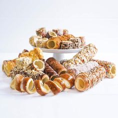 """""""The etymology of Chimney Cake refers to a stove chimney, since the fresh, steaming cake resembles a hot chimney. Kurtos Kalacs, Waffle Bowl Maker, Dessert Drinks, Desserts, Chimney Cake, Steamed Cake, Cake Makers, Hungarian Recipes, Candy Store"""