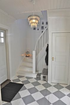 Hate the floor. Love the stairs but I wish the steps were black. I like that it almost looks like a secret staircase though. Entryway Stairs, Entry Hallway, House Stairs, Norwegian House, Swedish House, Hallway Decorating, Interior Decorating, White Painted Floors, Hallway Inspiration