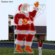Giant Santa commercial LED light display. Light motion for waving Santa. Professionally designed and built by hand in the U.S.A., using only the highest quality materials, including commercial grade LED C7 lights and fade-resistant, fine-cut garland for attractive daytime viewing. $4,499.00