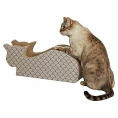 "Give your feline friend a place to play with this chic scratcher, showcasing a cat silhouette for whimsical appeal.   Product: Cat scratcherConstruction Material: PaperboardColor: TaupeFeatures: Cat silhouetteDimensions: 8.7"" H x 22"" W x 8.34"" DCleaning and Care: Wipe with dry cloth"