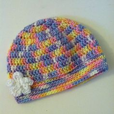 Small to Big Child size fitted beanie made with baby brights ombré 100 soft acrylic yarn. Flower is sewn on. Machine washable/dry able, do not bleach and do not iron. $16