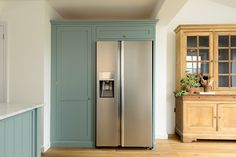 This big Samsung fridge/freezer combination fits perfectly next to our beautiful larder cabinet painted in the new 'Trinity Blue' Shaker colour