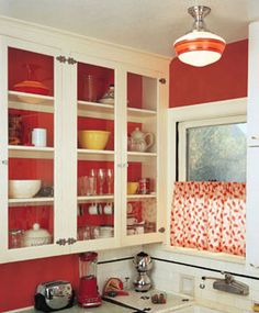 Vintage-inspired Red & White Kitchen. Love the glass front cabinets with red interior.