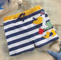 c245d17abc Nautical striped swim trunks from Mud Pie for boys feature lively pelican  applique.. A