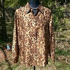 Animal Print Silk Bouse Pretty long sleeve button down front silk blouse. Nice brown shades in this animal print. CLOTHES Tops Blouses