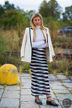 that is a lovely skirt. Ada Kokosar in between shows wearing a black and white maxi skirt.
