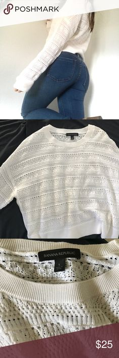 Banana Republic Sweater Great used condition.  White banana republic crochet sweater with a slit on each side as pictured.   Dress it with some heeled ankle boots and jeans, or some sneakers.  Or dress it up. Banana Republic Sweaters