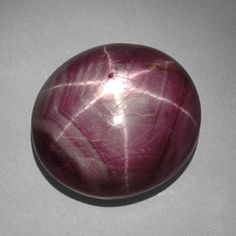 A star ruby shows asterism, a six-rayed star that shimmers over the surface of the stone when it is moved. Oriented rutile crystal inclusions cause the desired effect.