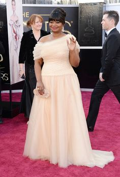 Actress Octavia Spencer wears a one-shoulder Tadashi Shoji gown, Lorraine Schwartz 18K rose gold and diamond signature mesh earrings and a Lorraine Schwartz signature 18K rose gold and diamond ring at the Academy Awards at the Dolby Theatre in Hollywood on Feb. 24, 2013. || Jason Merritt / Getty Images