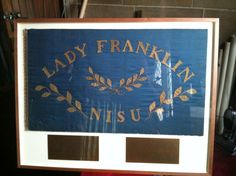 This flag was presented to Lieutenant William Hobson RN by Lady Jane Franklin in 1857, the year he set off to search for her husband Sir John Franklin who, then unbeknown to her and the rest of the world, had perished in the Arctic while searching for the northwest passage from Europe to America.